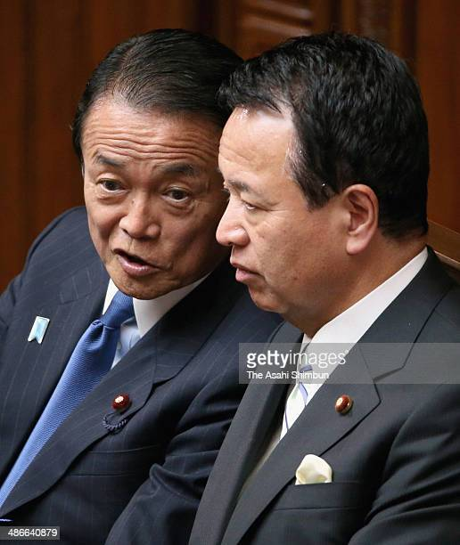 Finance Minister Taro Aso and states minister in charge of the Trans Pacific Partnership Akira Amari speak during the diet session on April 25 2014...