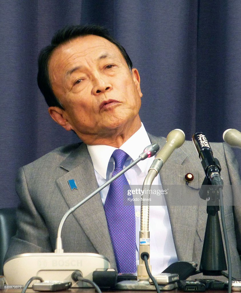 Finance Minister Taro Aso attends a press conference in Tokyo on May 31, 2016. Aso said he will accept a final decision by Prime Minister Shinzo Abe to postpone a consumption tax hike, although he had initially opposed the plan.