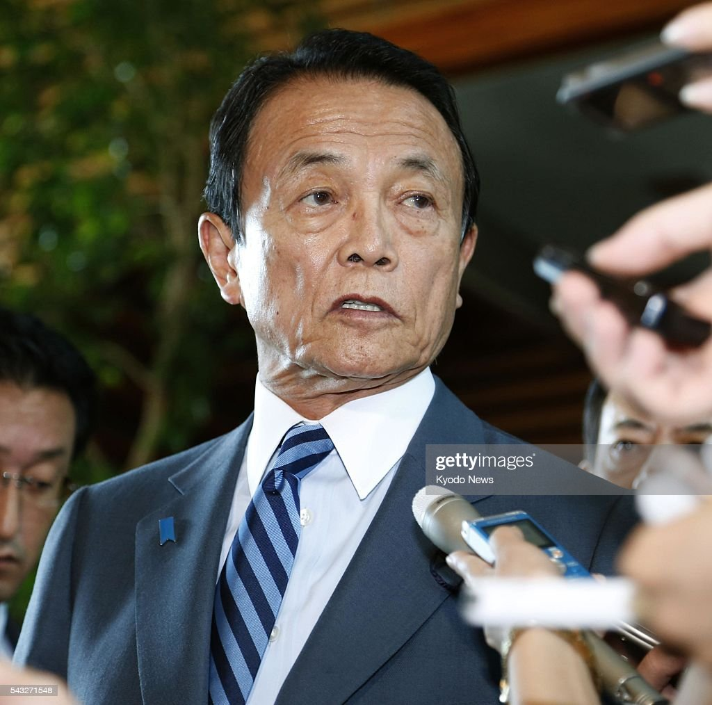 Finance Minister Taro Aso speaks with reporters at the prime minister's office in Tokyo on June 27, 2016, after a meeting with Prime Minister Shinzo Abe and Deputy Bank of Japan Governor Hiroshi Nakaso. The government and the central bank discussed measures to mitigate the impact on the economy from uncertainty over global growth following British voters' decision to leave the European Union.
