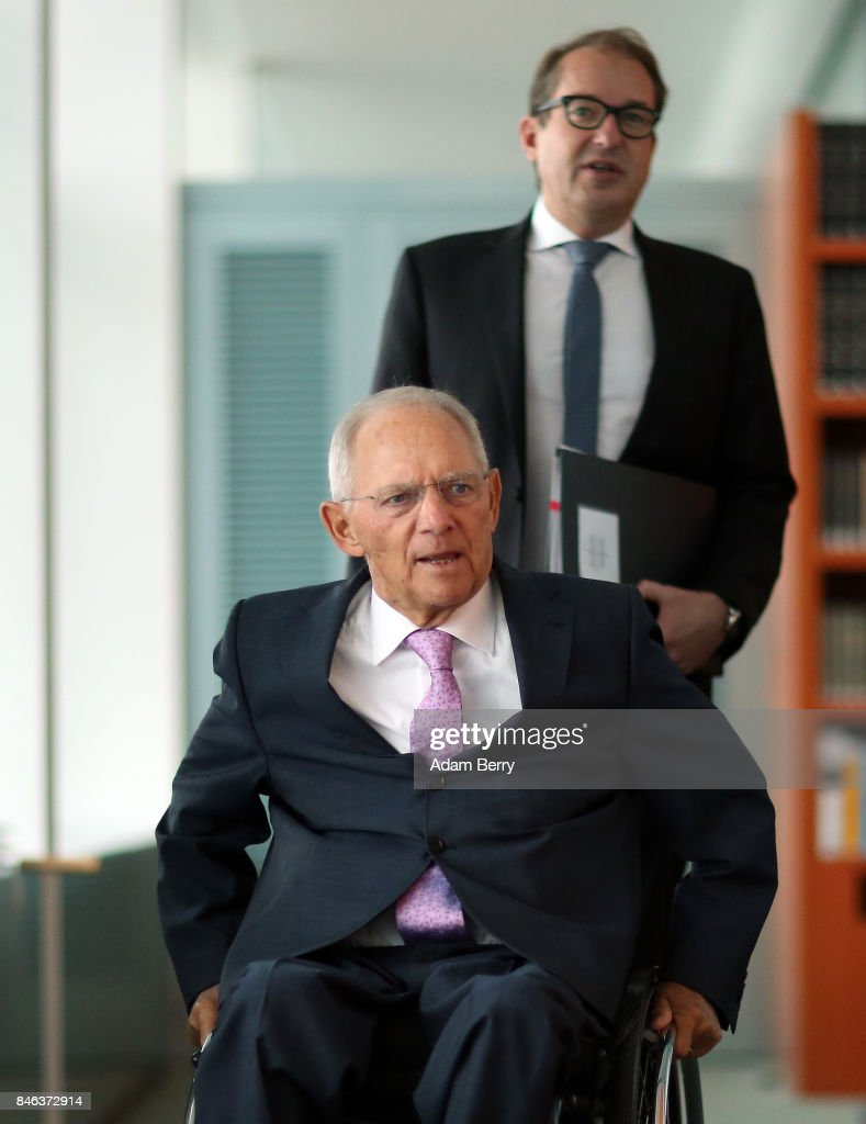 Finance Minister Wolfgang Schaeuble (CDU, L) and Transport and Digital Technologies Minister Alexander Dobrindt (CSU) arrive for the weekly German federal Cabinet meeting on September 13, 2017 in Berlin, Germany. High on the meeting's agenda was discussion of regional infrastructure.