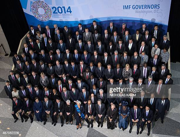 Finance ministers and central bank governors pose for a family photo of the International Monetary and Financial Committee ahead of the group's...