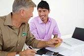 Financial adviser and client with credit card and documents