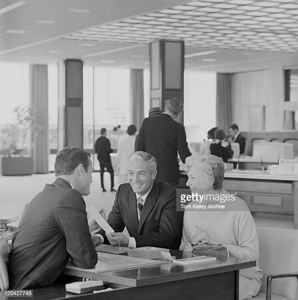 Financial adviser talking to couple, smiling
