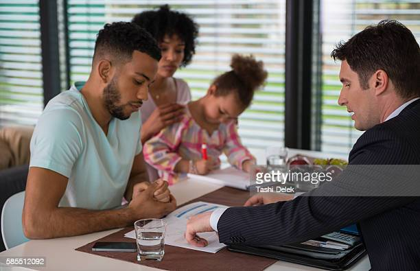 Financial Advisor Dicussing With Couple