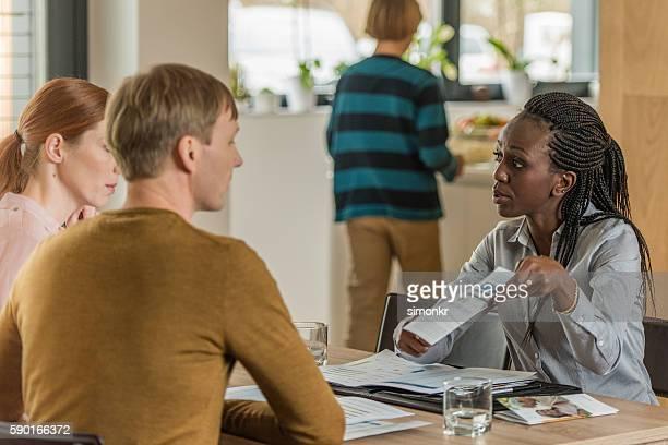 Financial advisor explaining brochure