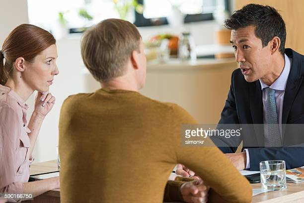 Financial advisor explaining document