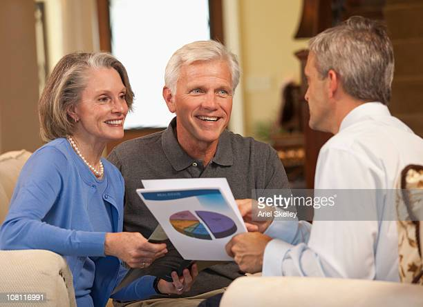 Financial advisor explaining investments to couple