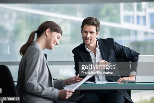 Financial advisor meeting with satisfied investor