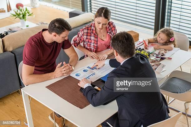 Financial advisor pointing brochure