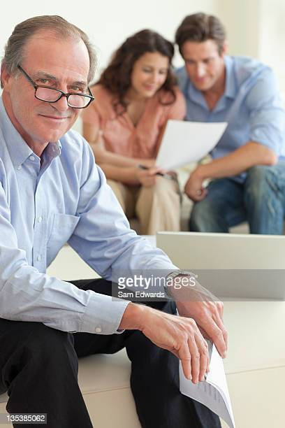 Financial advisor sitting with couple
