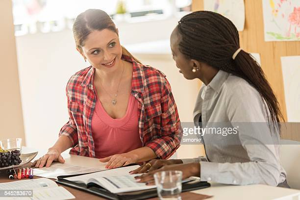 Financial advisor talking to woman