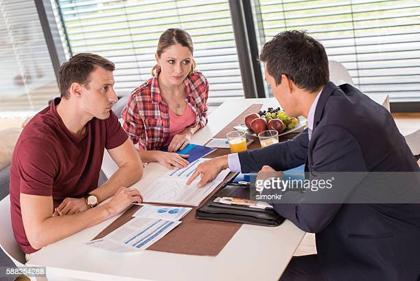 Financial advisor talking with couple