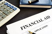 Financial aid application on a desk. Student loan.