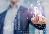Businessman presenting financial analysis with charts generated by big data displaying international success and dollar signs