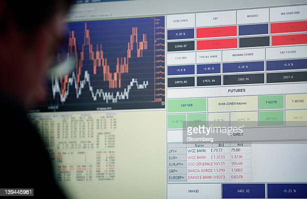 Financial data is displayed on an employee's computer screen inside the Banca d'Italia Italy's central bank in Rome Italy on Tuesday Feb 21 2012 Bank...