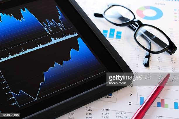 Financial figures with digital tablet