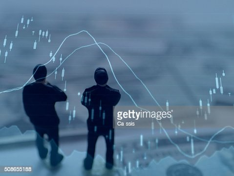Financial graphs analysis and Businessman : Stock Photo