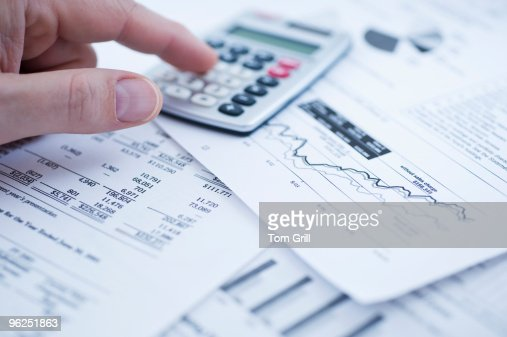 Financial graphs with calculator : Stock Photo