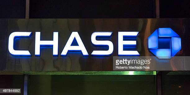 Financial institutions in New York Chase bank signage and logo glowing on its building in NYC JPMorgan Chase Bank NA doing business as Chase is a...