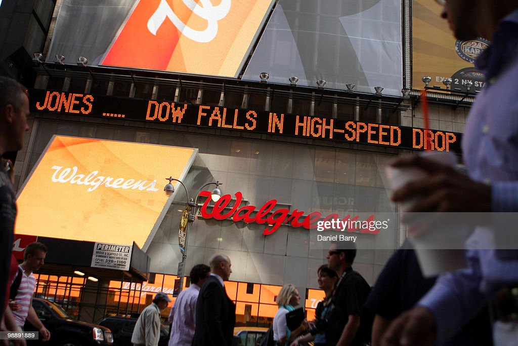 Financial news of todays turbulent stock market is displayed on a news ticker in Times Square May 6, 2010 in New York City. The Dow Jones industrials plunged nearly 1,000 points before ending the day down at 347.