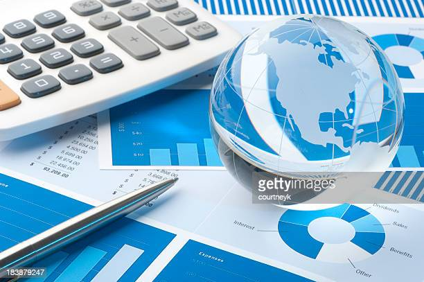 Financial papers with globe