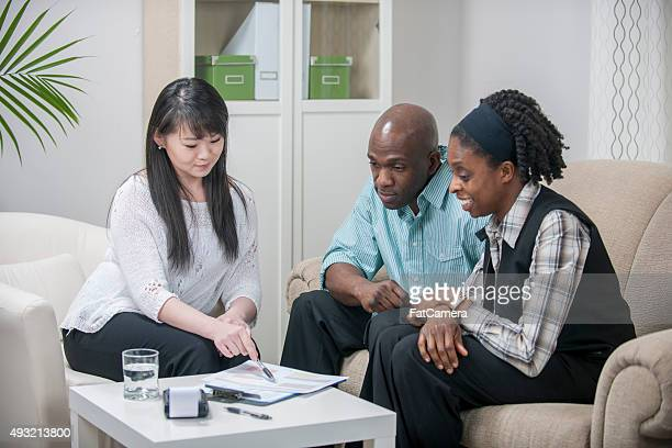 Financial Planner Helping a Couple with Their Budget