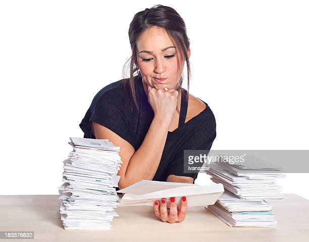 Financial Problems, Young Woman with Unpaid Bills and Paperwork Overload