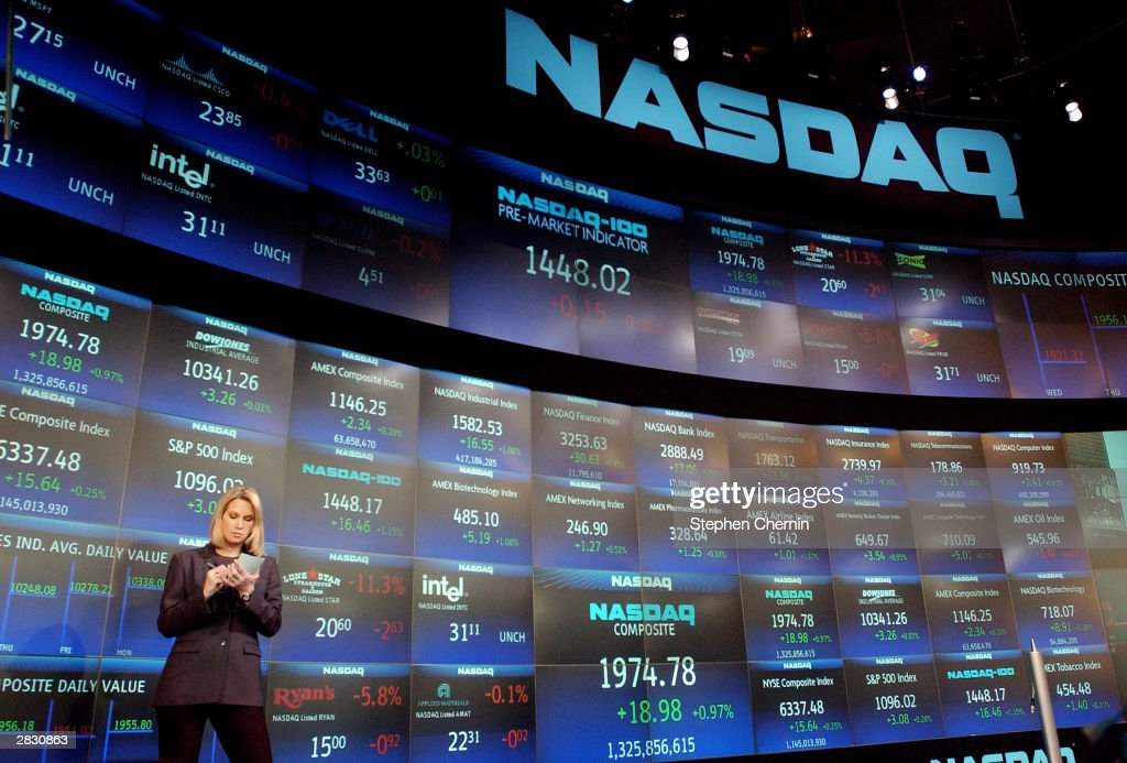 Financial reporter Carrie Lee prepares for her morning market report at the NASDAQ market site December 24 2003 in New York CIty NASDAQ has...