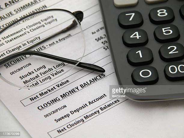 Financial Statement with Glasses and Calculator