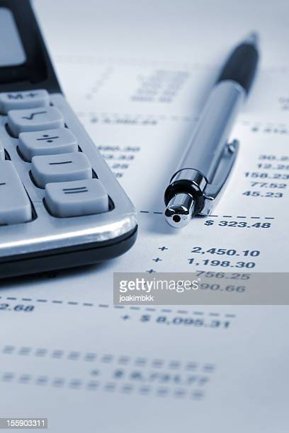 Financial statement with pen and calculator