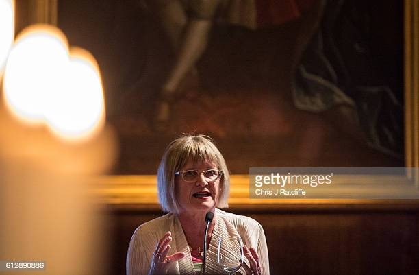 Financial Times wine critic Jancis Robinson talks on a podium about the wines being drunk at Draper's Hall during the Room to Read's Annual Wine Gala...