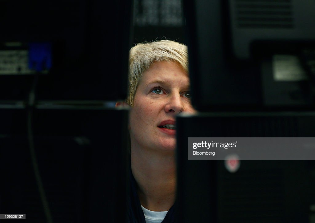 A financial trader monitors data on computer screens at the Frankfurt Stock Exchange in Frankfurt, Germany, on Friday, Jan. 11. 2013. European stocks pared their decline as Italy's borrowing costs dropped at a debt sale, offsetting concern that China has less room for monetary easing after a reported showed inflation increased more than estimated. Photographer: Ralph Orlowski/Bloomberg via Getty Images