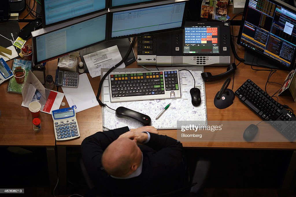 A financial trader monitors data on computer screens on the trading floor inside the Amsterdam Stock Exchange, operated by Euronext NV, a unit of IntercontinentalExchange Group Inc. (ICE), in Amsterdam, Netherlands, on Tuesday, Jan. 14, 2014. ICE plans to sell as much as 30 percent of Euronext NV before the operator of the Paris and Amsterdam exchanges goes public this year, three people with knowledge of the matter said. Photographer: Jasper Juinen/Bloomberg via Getty Images