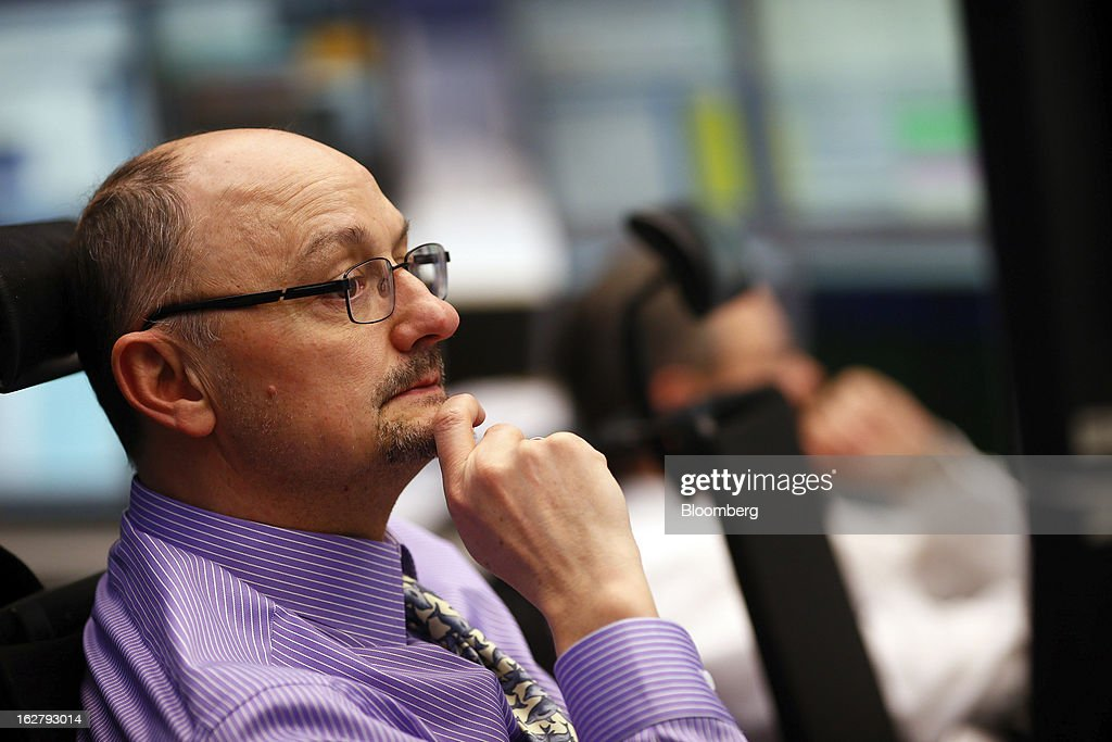 A financial trader monitors data on his computer screens at the Frankfurt Stock Exchange in Frankfurt, Germany, on Tuesday, Feb. 27, 2013. Stocks rose, the euro strengthened from a seven-week low and Italian 10-year bonds gained after the country sold 6.5 billion euros ($8.5 billion) of debt amid political turmoil. Photographer: Ralph Orlowski/Bloomberg via Getty Images