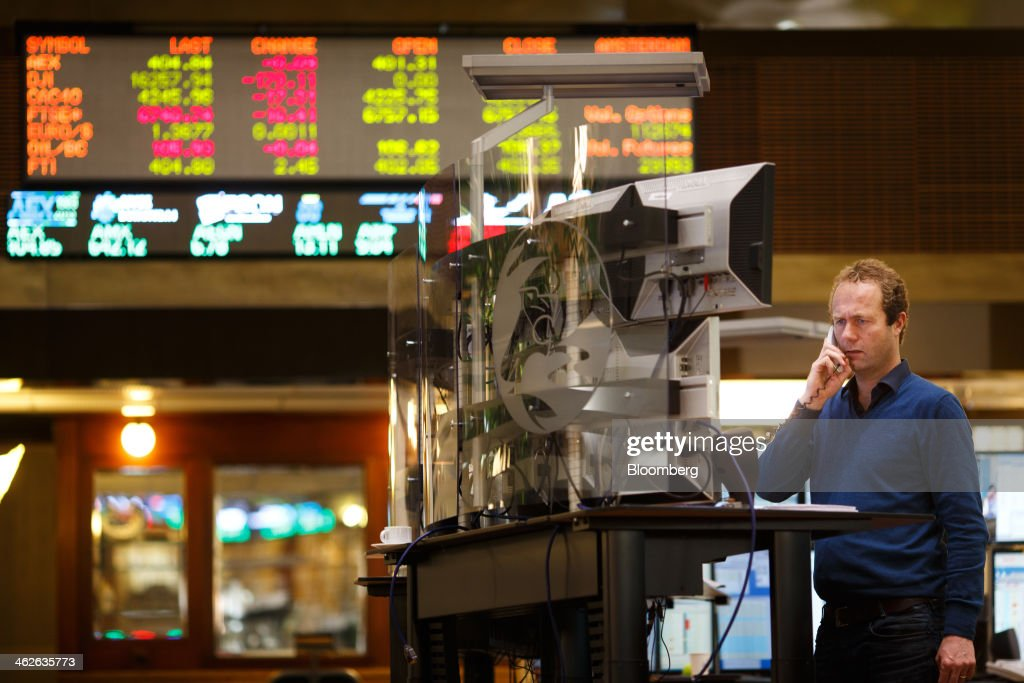 A financial trader speaks on a fixed line telephone on the trading floor inside the Amsterdam Stock Exchange, operated by Euronext NV, a unit of IntercontinentalExchange Group Inc. (ICE), in Amsterdam, Netherlands, on Tuesday, Jan. 14, 2014. ICE plans to sell as much as 30 percent of Euronext NV before the operator of the Paris and Amsterdam exchanges goes public this year, three people with knowledge of the matter said. Photographer: Jasper Juinen/Bloomberg via Getty Images