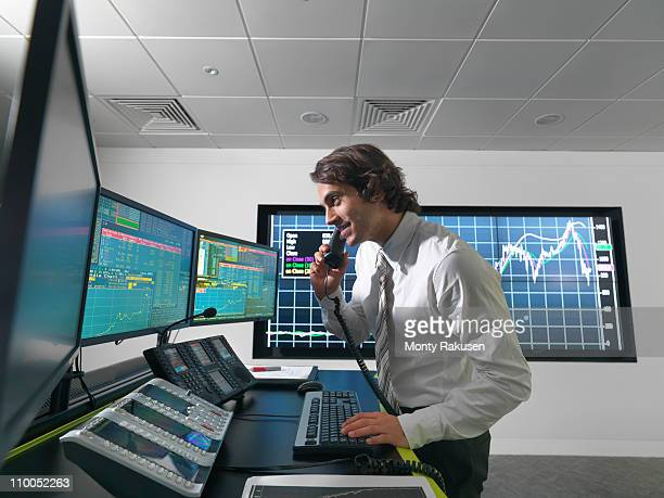Financial trader with screens