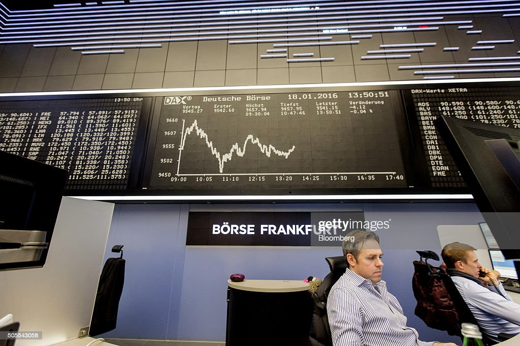 Financial traders monitor data as they sit below the DAX Index curve inside the Frankfurt Stock Exchange in Frankfurt Germany on Monday Jan 18 2016...