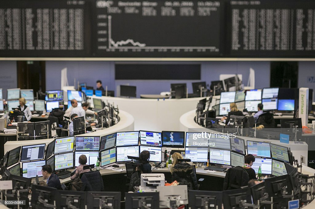Financial traders monitor data below the DAX Index curve at the Frankfurt Stock Exchange in Frankfurt Germany on Monday Jan 4 2016 Financial markets...