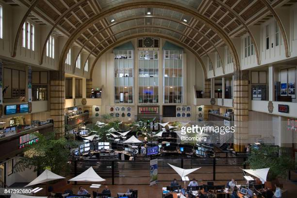Financial traders monitor data inside the Amsterdam Stock Exchange operated by Euronext NV in Amsterdam Netherlands on Friday Sept 15 2017 Frankfurt...