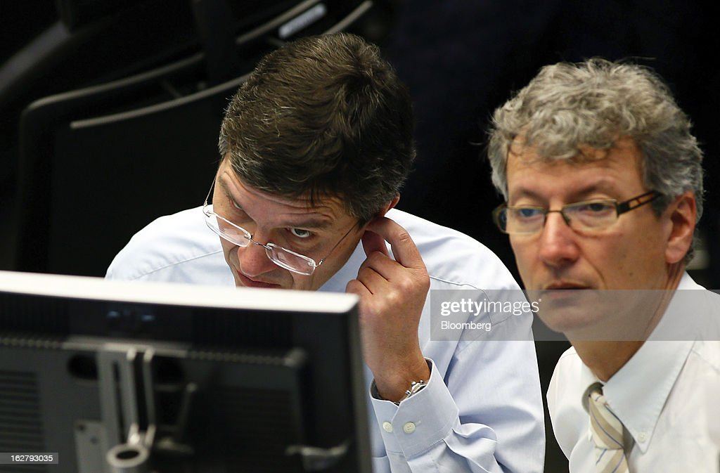 Financial traders monitor data on a computer screen inside the Frankfurt Stock Exchange in Frankfurt, Germany, on Tuesday, Feb. 27, 2013. Stocks rose, the euro strengthened from a seven-week low and Italian 10-year bonds gained after the country sold 6.5 billion euros ($8.5 billion) of debt amid political turmoil. Photographer: Ralph Orlowski/Bloomberg via Getty Images