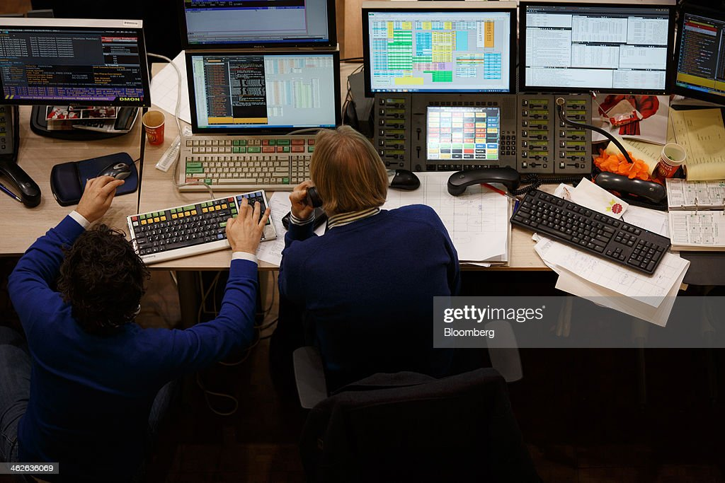 Financial traders monitor data on computer screens on the trading floor at Amsterdam Stock Exchange (AEX), operated by Euronext NV, a unit of IntercontinentalExchange Group Inc. (ICE), in Amsterdam, Netherlands, on Tuesday, Jan. 14, 2014. ICE plans to sell as much as 30 percent of Euronext NV before the operator of the Paris and Amsterdam exchanges goes public this year, three people with knowledge of the matter said. Photographer: Jasper Juinen/Bloomberg via Getty Images