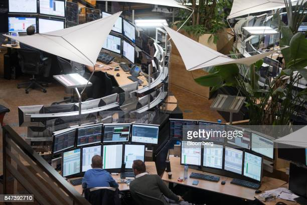 Financial traders monitor data on computer screens on the trading floor inside the Amsterdam Stock Exchange operated by Euronext NV in Amsterdam...
