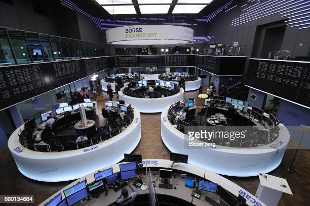 Financial traders watch data screens at the Frankfurt Stock Exchange operated by Deutsche Boerse AG as the UK triggers Article 50 of the Lisbon...