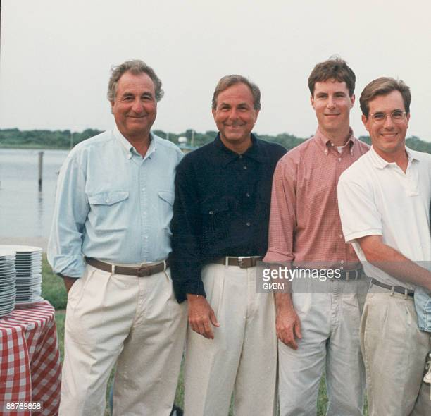 ACCESS*** Financier Bernard Madoff with his brother Peter Madoff and sons Andrew Madoff and Mark Madoff during July 1995 in Montauk NY