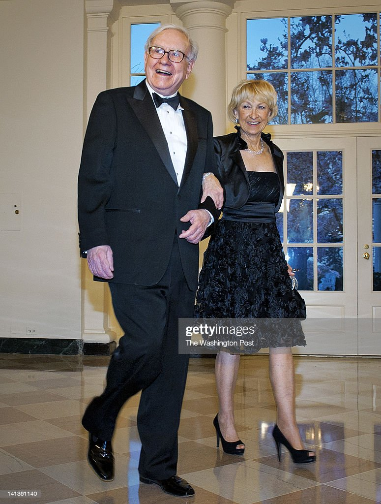 Financier Warren Buffett and wife Astrid Buffett arrive for tonight's State dinner for the Prime Minister of Great Britain at the White House on March, 14, 2012 in Washington, DC.
