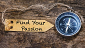 Find your passion - motivation phrase handwriting on label with compass
