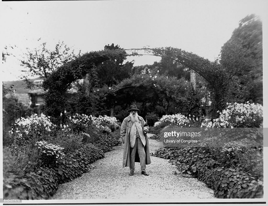 Fine art painter <a gi-track='captionPersonalityLinkClicked' href=/galleries/search?phrase=Claude+Monet&family=editorial&specificpeople=79875 ng-click='$event.stopPropagation()'>Claude Monet</a> stands on a walkway near a trellis in his garden at Giverny.