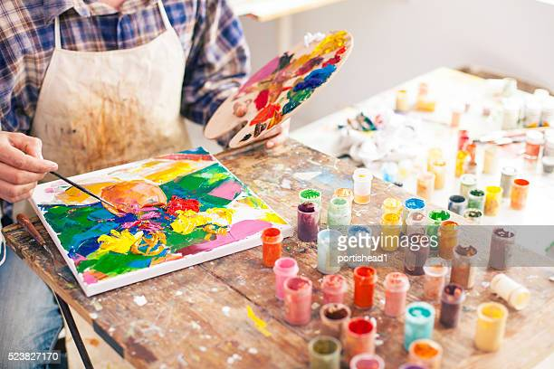 Fine art painter creating a new masterpiece