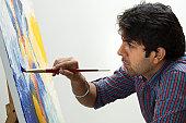 fine art painter painting on canvas