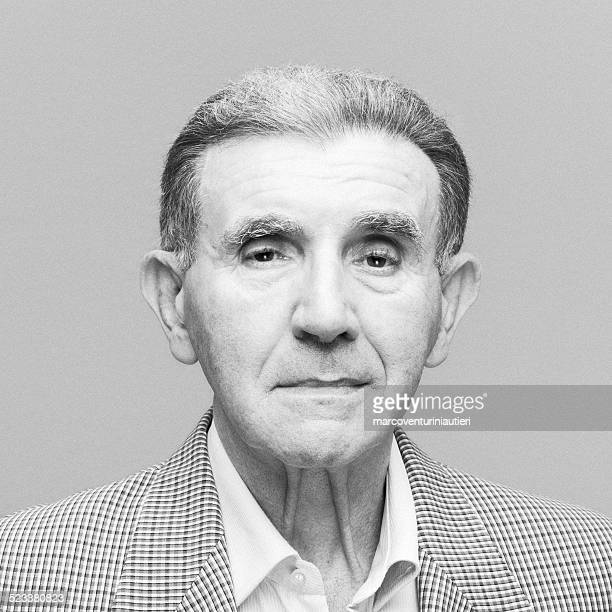 Fine art portrait of a senior man looking at camera
